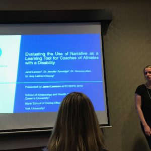 A Revved Up Research Lab member presenting research findings at an academic conference