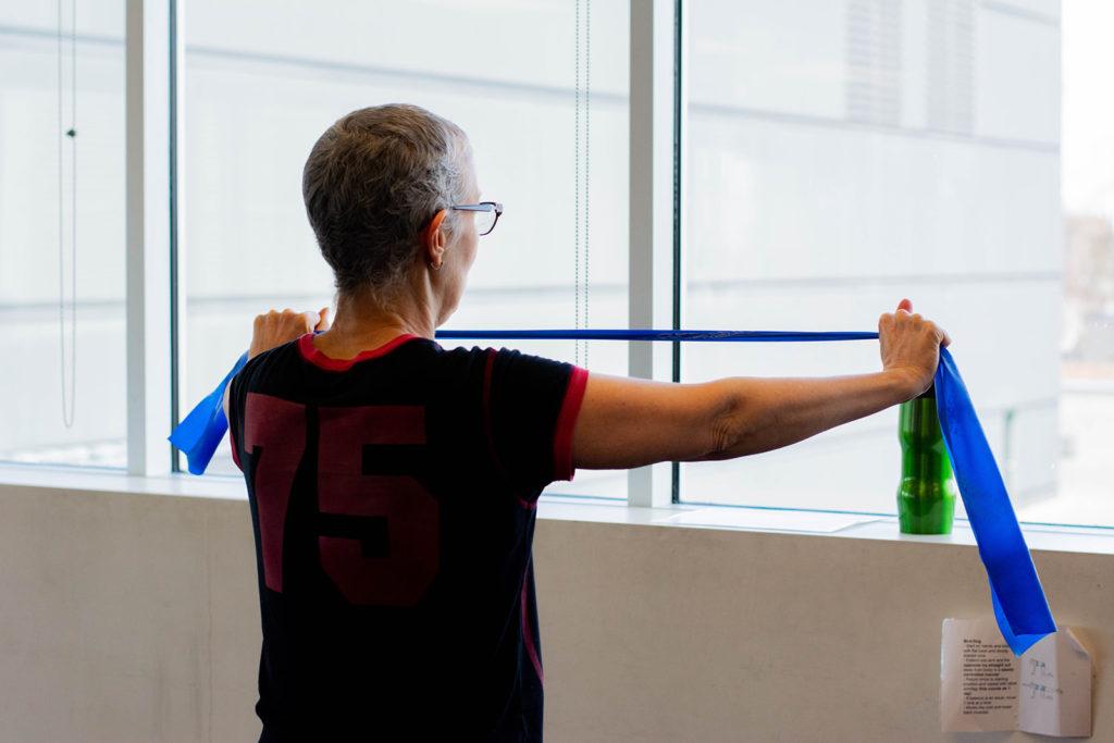 A breast cancer survivor exercising at Revved Up