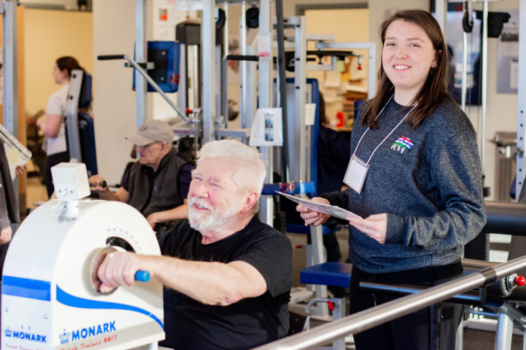 A Revved Up member exercising with a volunteer